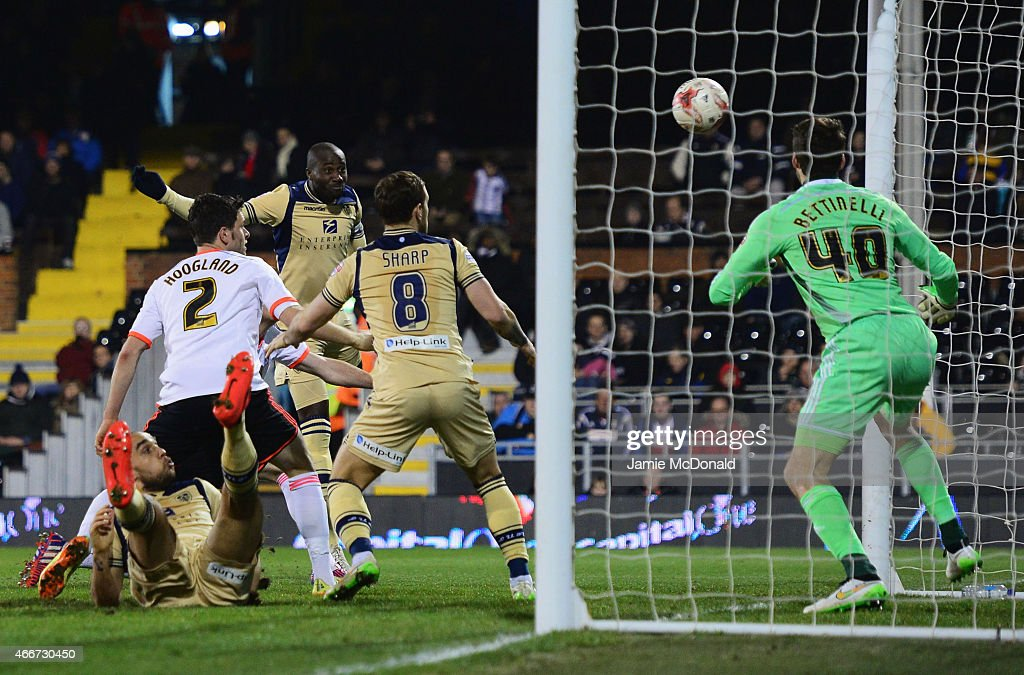 Souleymane Bamba of Leeds United (C) scores their second goal past goalkeeper Marcus Bettinelli of Fulham during the Sky Bet Championship match between Fulham and Leeds United at Craven Cottage on March 18, 2015 in London, England.