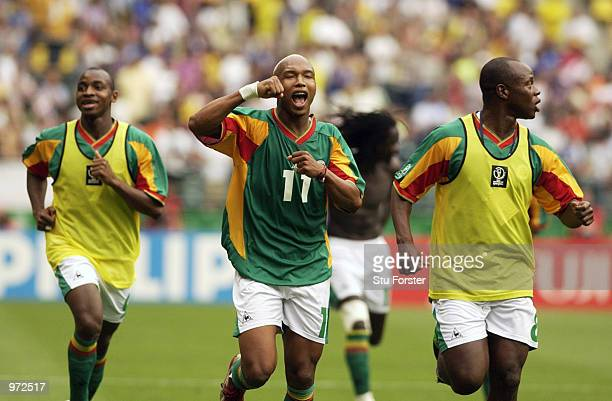 Souleymane Camara El Hadji Diouf and Amara Traore of Senegal celebrate after the Sweden v Senagal World Cup Second Round match played at the Oita Big...