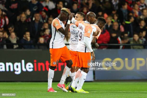 Souleymane Camara of Montpellier celebrates with Junior Sambia of Montpellier after scoring a goal during the French League Cup match between EA...