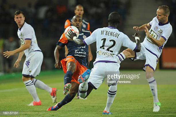 Souleymane Camara of Montpellier Herault SC is challenged during the Ligue 1 match between Montpellier Herault SC and Toulouse FC at Stade de la...