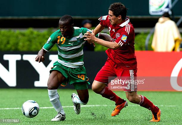 Souleymane Coulibaly of Ivory Coast struggles for the ball with Frederik Holst of Denmark during the FIFA U17 World Cup Mexico 2011 Group F match...