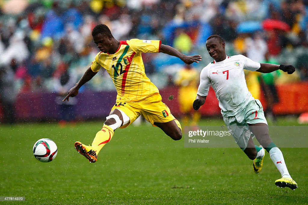 Souleymane Coulibaly of Mali kicks ahead past Ibrahima Wadji of Senegal during the FIFA U-20 World Cup Third Place Play-off match between Senegal and Mali at North Harbour Stadium on June 20, 2015 in Auckland, New Zealand.