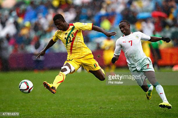 Souleymane Coulibaly of Mali kicks ahead past Ibrahima Wadji of Senegal during the FIFA U-20 World Cup Third Place Play-off match between Senegal and...