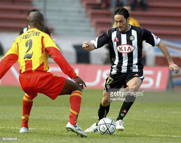 Souleymane Diamoutene of Lecce and David Di Michele of Udinese in action during the Serie A match between Udinese and Lecce on March 20 2005 in Udine...