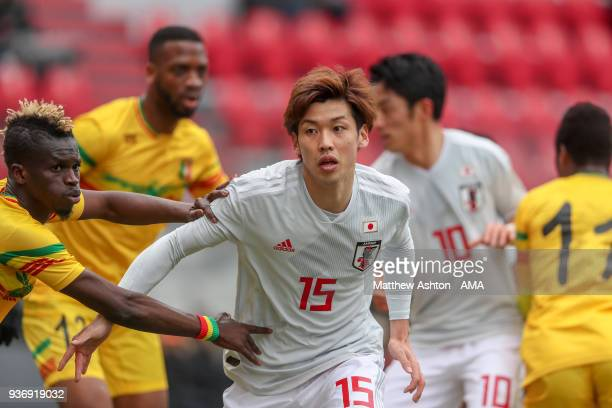 Souleymane Diarra of Mali holds on to Yuya Osako of Japan during the International friendly match between Japan and Mali at the Stade de Sclessin on...