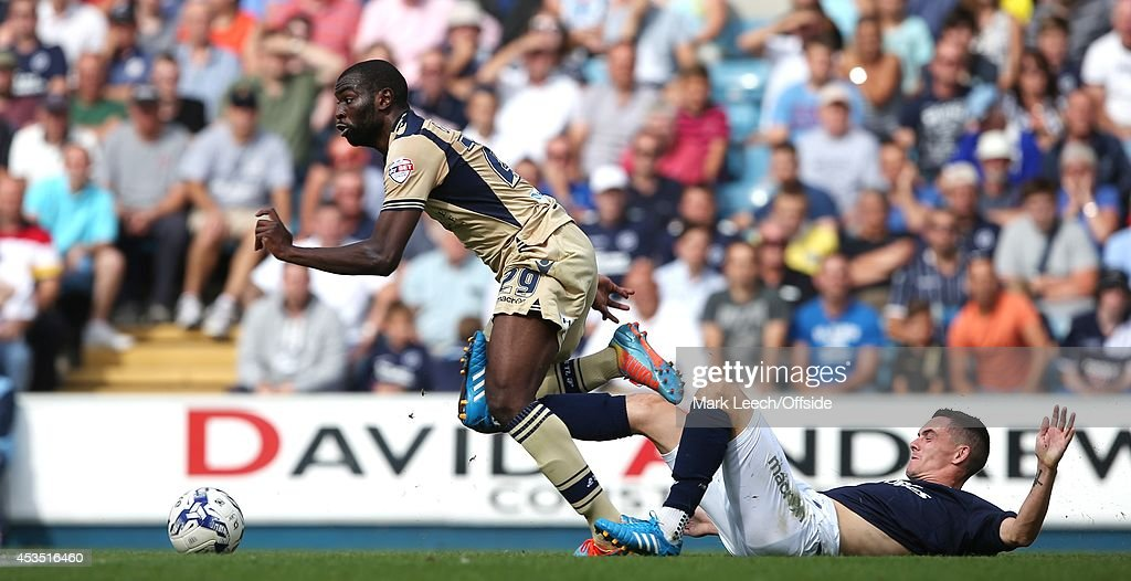 Souleymane Doukara of Leeds and Shaun Williams of Millwall in action during the Sky Bet Championship match between Millwall and Leeds United at The Den on August 9, 2014 in London, England.