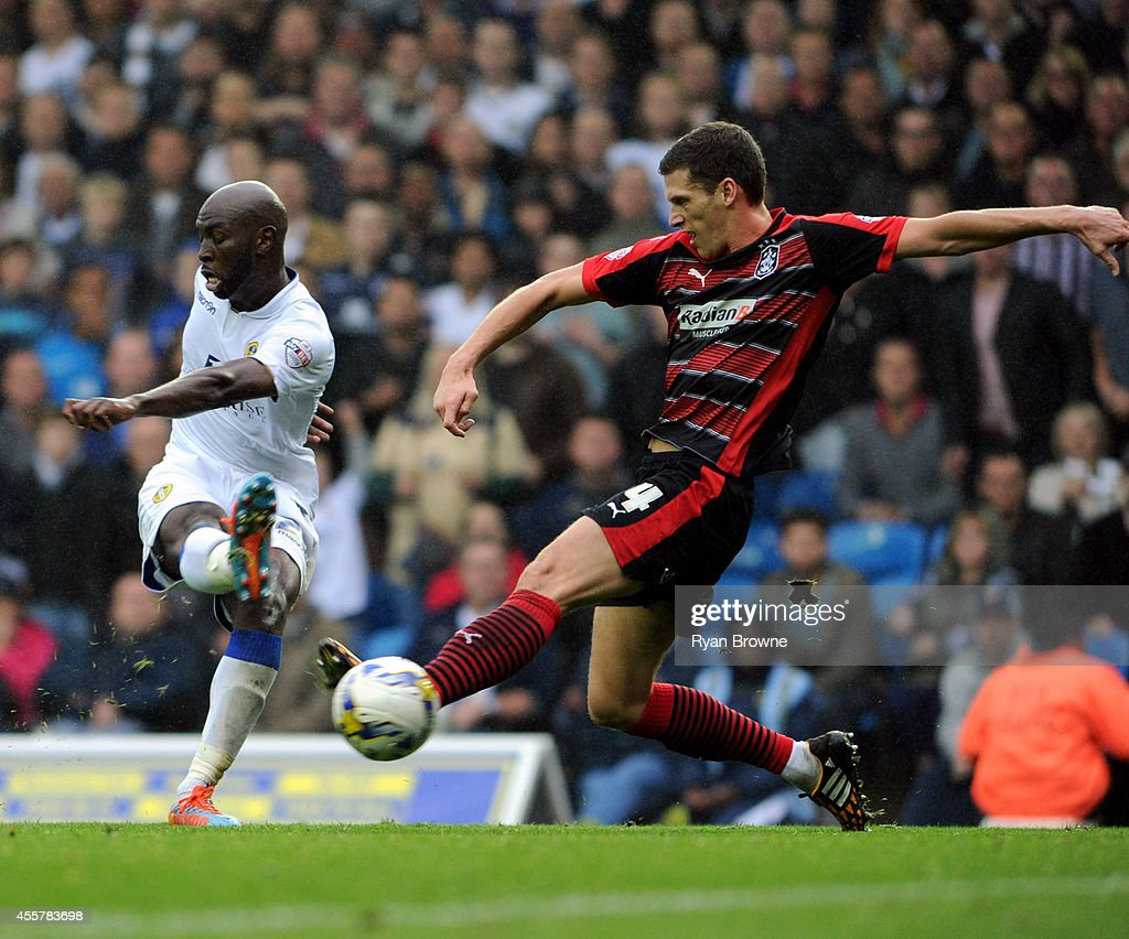 Souleymane Doukara of Leeds (L) scores the 3rd goal during Sky Bet Championship match between Leeds United and Huddersfield Town at Elland Road Stadium on September 20, 2014 in Leeds, United Kingdom.