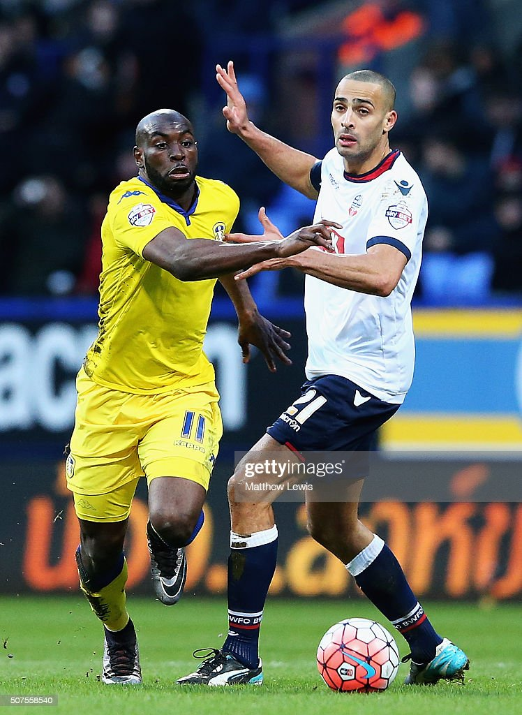 Souleymane Doukara of Leeds United and Darren Pratley of Bolton Wanderers chalenge for the ball during The Emirates FA Cup Fourth Round match between Bolton Wanderers v Leeds United at Macron Stadium on January 30, 2016 in Bolton, England.