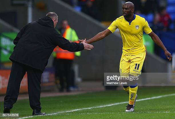 Souleymane Doukara of Leeds United celebrates his goal with manager Steve Evans during The Emirates FA Cup Fourth Round match between Bolton...