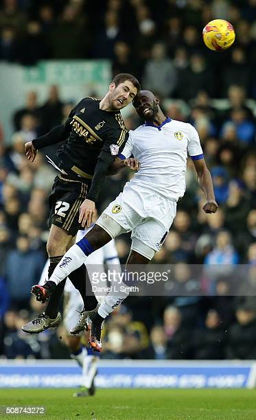 Souleymane Doukara of Leeds United FC and Gary Gardner of Nottingham Forest FC head the ball during the Sky Bet Championship match between Leeds...
