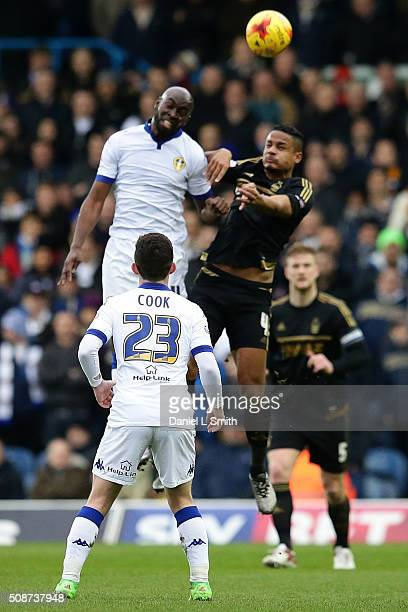 Souleymane Doukara of Leeds United FC and Michael Mancienne of Nottingham Forest FC head the ball during the Sky Bet Championship match between Leeds...