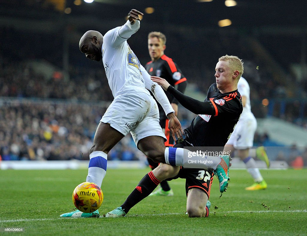 Souleymane Doukara (L) of Leeds United is tackled by Jack Grimmer of Fulham battle for the ball during the Sky Bet Championship match between Leeds United and Fulham at Elland Road on December 13, 2014 in Leeds, England.