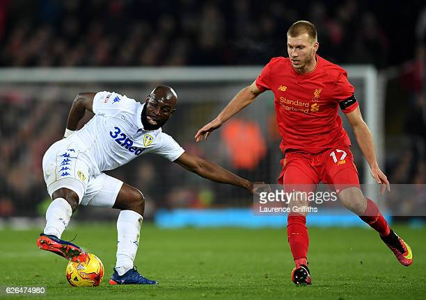 Souleymane Doukara of Leeds United is watched by Ragnar Klavan of Liverpool during the EFL Cup QuarterFinal match between Liverpool and Leeds United...