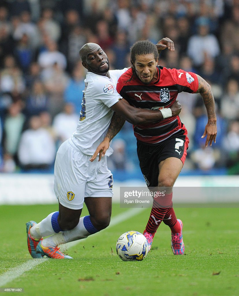 Souleymane Doukara of Leeds vies with Sean Scannell (R) of Huddersfield Town during Sky Bet Championship match between Leeds United and Huddersfield Town at Elland Road Stadium on September 20, 2014 in Leeds, United Kingdom.