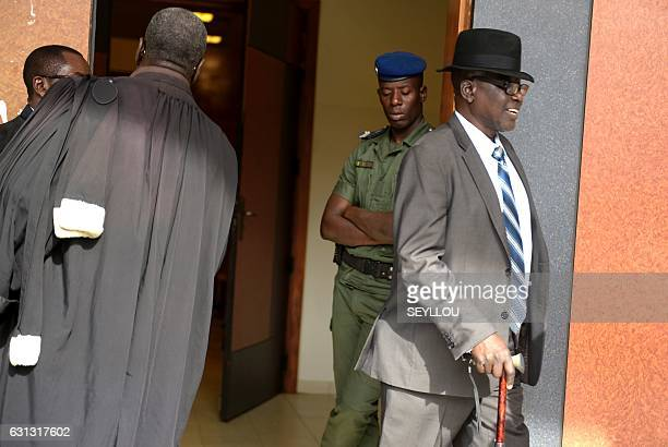 Souleymane Guengueng of the Association of Victims of the regime of former Chadian dictator Hissene Habre walks out the courtroom at Dakar courthouse...