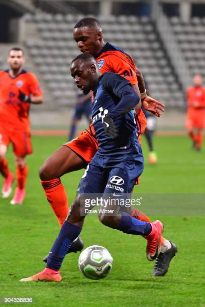 Souleymane Karamoko of Paris FC and Christopher Martins Pereira of FBBP 01 during the Ligue 2 match between Paris FC and Bourg en Bresse at Stade...