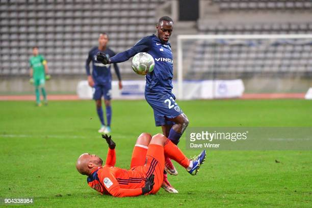 Souleymane Karamoko of Paris FC and Thomas Gamiette of FBBP 01 during the Ligue 2 match between Paris FC and Bourg en Bresse at Stade Charlety on...