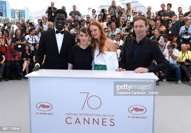 Souleymane Seye Ndiaye director Leonor Serraille Laetitia Dosch and Gregoire Monsaingeon attend the 'Jeune Femme' photocall during the 70th annual...