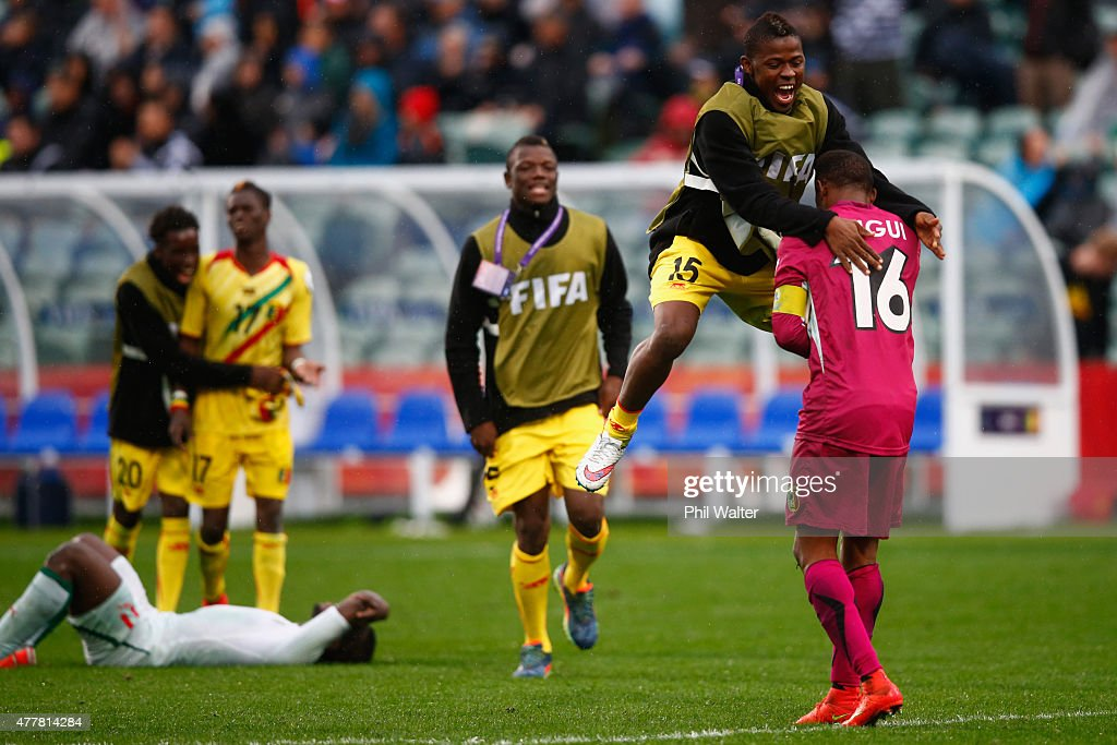 Souleymane Sissoko of Mali celebrates with goal keeper Djigui Diarra following the FIFA U-20 World Cup Third Place Play-off match between Senegal and Mali at North Harbour Stadium on June 20, 2015 in Auckland, New Zealand.