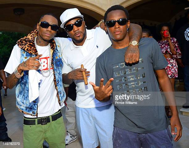 Soulja Boy Young Jeezy and Jadarius Jenkins attend the sweet 16 birthday party for Young Jeezy's son Jadarius Jenkins on July 29 2012 in Atlanta...