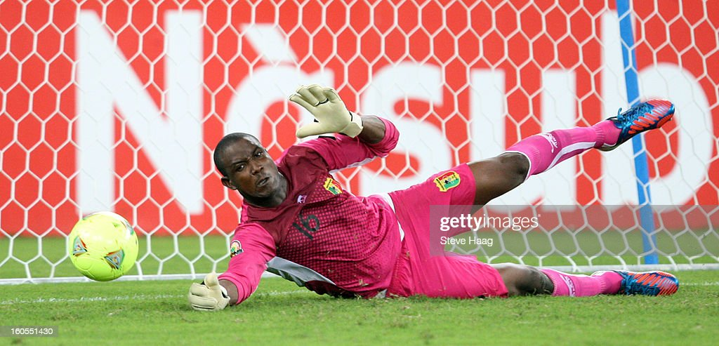 Soumaila Diakite, goal keeper of Mali, saves a shot from Dean Furman of South Africa during the 2013 African Cup of Nations Quarter-Final match between South Africa and Mali at Moses Mahbida Stadium on February 02, 2013 in Durban, South Africa.