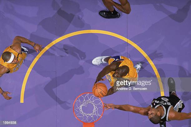 Soumaila Samake of the Los Angeles Lakers grabs a rebound during the NBA game against the San Antonio Spurs at Staples Center on October 29 2002 in...