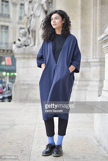 Soumaili Blein poses wearing a Monki coat before the Alexis Mabille presentation at the Opera Garnier on July 8 2015 in Paris France