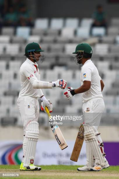 Soumya Sarkar and Tamim Iqbal knocking there gloves during day one of the First Test match between Bangladesh and Australia at Shere Bangla National...