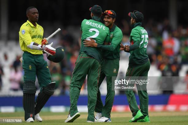 Soumya Sarkar of Bangladesh and Shakib Al Hasan of Bangladesh and Masrafe Mortaza of Bangladesh celebrate victory during the Group Stage match of the...