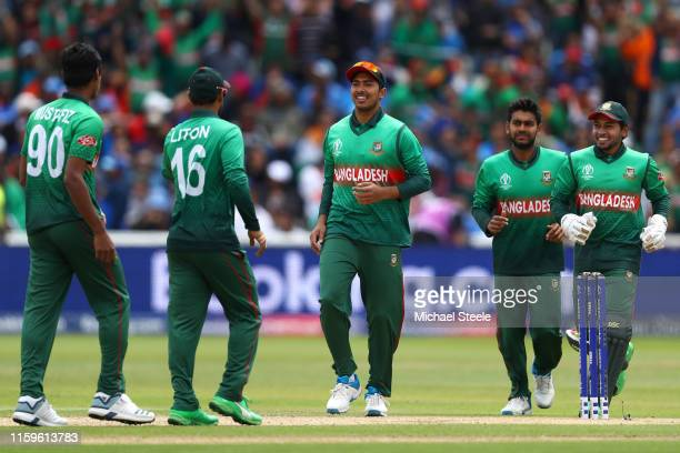 Soumya Sarkar of Bangladesh looks towards Mustafizur Rahman after the wicket of Hardik Pandya of India during the Group Stage match of the ICC...