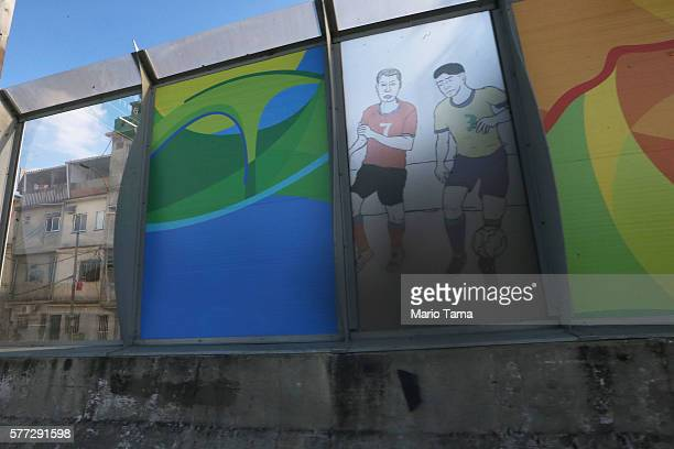 A 'sound barrier' with posters advertising the Olympics is attached along a stretch of the main highway which links Rio's international airport to...