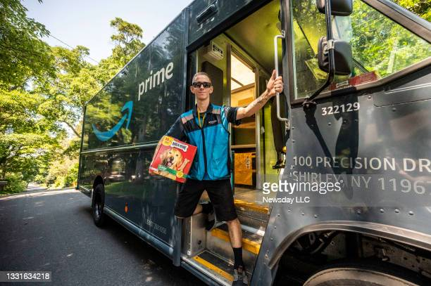 """Amazon delivery man Joseph Sammarco of Mastic Beach, New York, aka """"The Mystery Milk Bone Guy"""" delivering packages and Milk Bone dog treats for the..."""