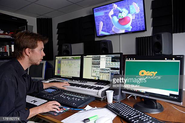 A sound designer works in the postproduction of the animated film Oggy and the Cockroaches on July 30 2013 at the Xilam French animation production...