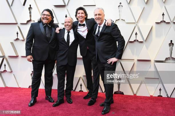 Sound Editors for 'Roma' Sergio Diaz Jose Antonio Garcia Craig Henighan and Skip Lievsay attend the 91st Annual Academy Awards at Hollywood and...