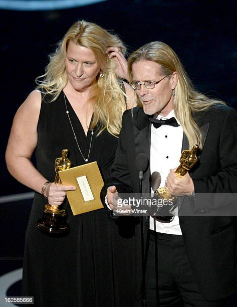 Sound editors Karen Baker Landers and Per Hallberg accept the Best Sound Editing award for 'Skyfall' onstage during the Oscars held at the Dolby...