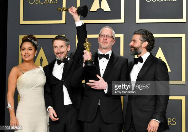 "Sound editors Mark Taylor and Stuart Wilson, winners of the Sound Mixing award for ""1917,"" pose with Salma Hayek and Oscar Isaac in the press room..."
