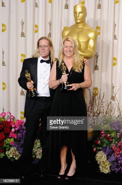 Sound editors Per Hallberg and Karen Baker Landers pose in the press room during the Oscars at the Loews Hollywood Hotel on February 24, 2013 in...