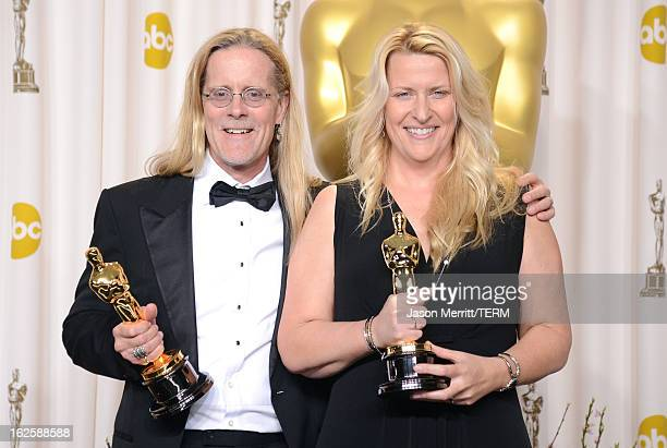 Sound editors Per Hallberg and Karen Baker Landers winners of the Best Sound Editing award for 'Skyfall' pose in the press room during the Oscars...