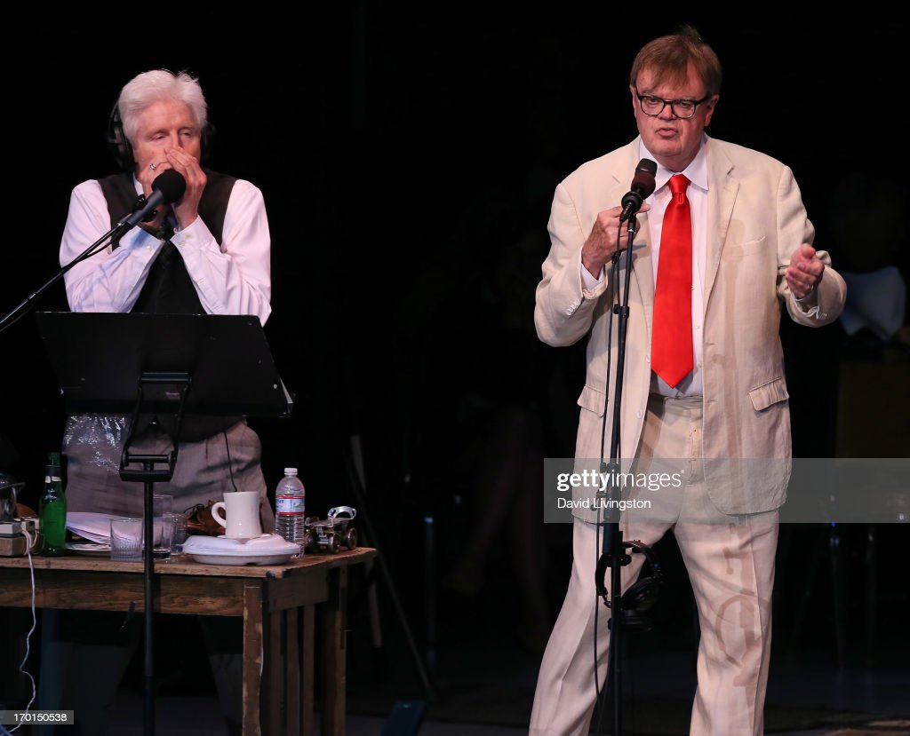 Sound effects artist Fred Newman (L) and radio personality Garrison Keillor of A Prairie Home Companion perform on stage at the Greek Theatre on June 7, 2013 in Los Angeles, California.