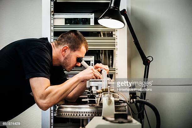Sound engineer checking record master
