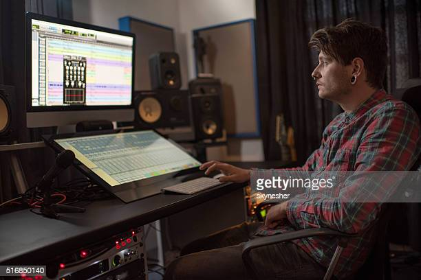 sound engineer composing on computer in music studio. - editor stock pictures, royalty-free photos & images