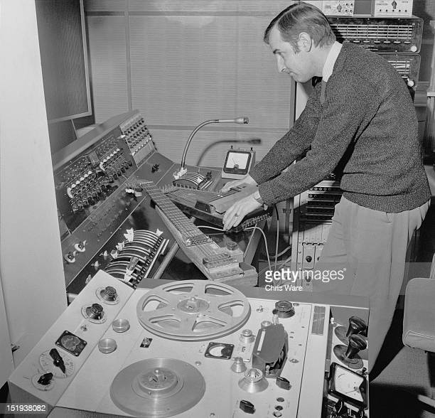 Sound engineer Dick Mills with a lap steel guitar and a zither at the BBC Radiophonic Workshop at the BBC's Maida Vale studios London 22nd March 1969