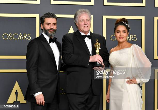 "Sound engineer Donald Sylvester, winner of the Sound Editing award for ""Ford v Ferrar,"" poses with Oscar Isaac and Salma Hayek in the press room..."