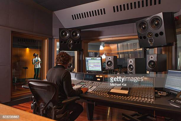 sound engineer using mixing desk - sound recording equipment stock pictures, royalty-free photos & images