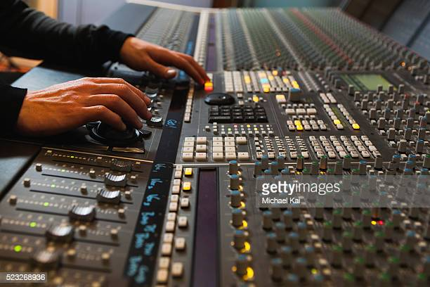 Sound engineer using mixing desk