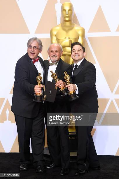 Sound engineers Mark Weingarten Gregg Landaker and Gary A Rizzo winners of the Best Sound Mixing award for 'Dunkirk' pose in the press room during...