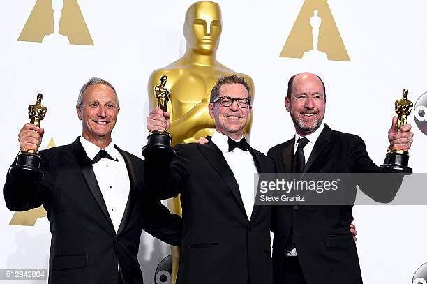 Sound mixers Ben Osmo Greg Rudloff and Chris Jenkins winners of the Best Sound Mixing award for 'Mad Max Fury Road' pose in the press room during the...