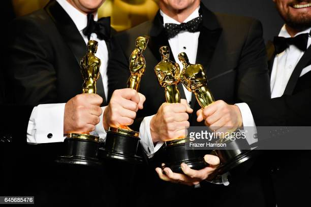 Sound mixers Peter Grace Robert Mackenzie Kevin O'Connell and Andy Wright winners of the Best Sound Mixing award for 'Hacksaw Ridge' pose in the...