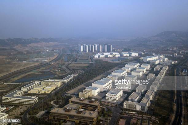 Sound stages and backlots stand at the Dalian Wanda Group Co Oriental Movie Metropolis film production hub in this aerial photograph taken in Qingdao...