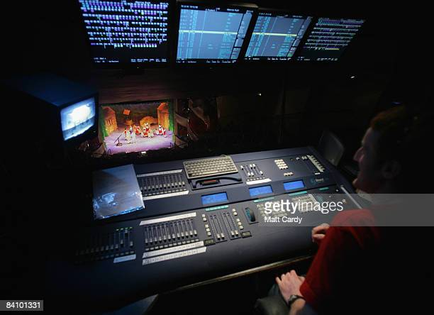 A sound technician watches from his sound desk as the production of the traditional pantomime Jack and the Beanstalk is shown on stage at the Theatre...